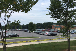 The Centennial High School parking lot, where crews towed more than 180 inoperable vehicles after the Ellicot City flood. (WTOP/Jamie Forzato)