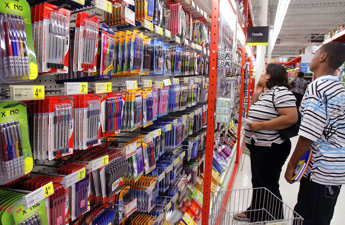 FILE-    In this Monday, Aug. 24, 2009 file photo, parents and students shop for back-to-school supplies at the Staples Office Supply store in Springfield, Ill. It's that time of year again. Millions of parents are about to embark on the annual scavenger hunt known as back-to-school shopping.  (AP Photo/Seth Perlman, FILE)