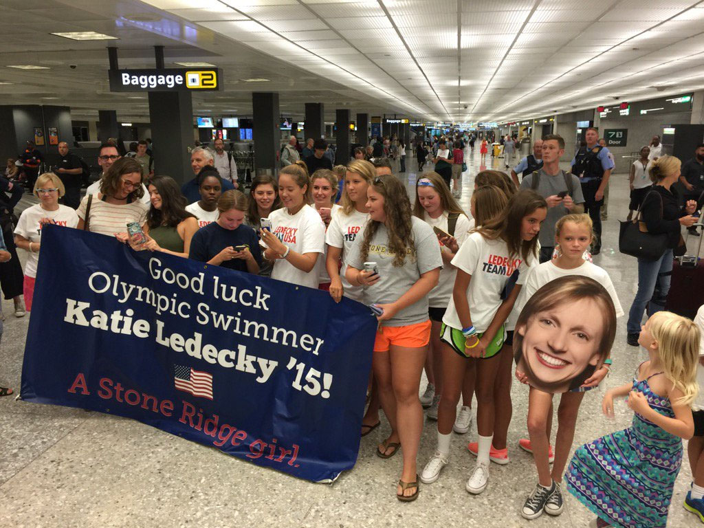Well-wishers wait for Katie Ledecky to arrive from Rio at Dulles International Airport Aug. 17. (WTOP/Kristi King)