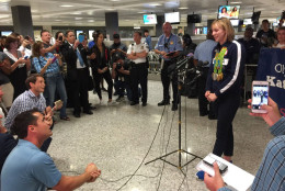 A four-time gold medalist in Rio, swimmer Katie Ledecky addresses the media at Dulles International Airport. (WTOP/Kristi King)