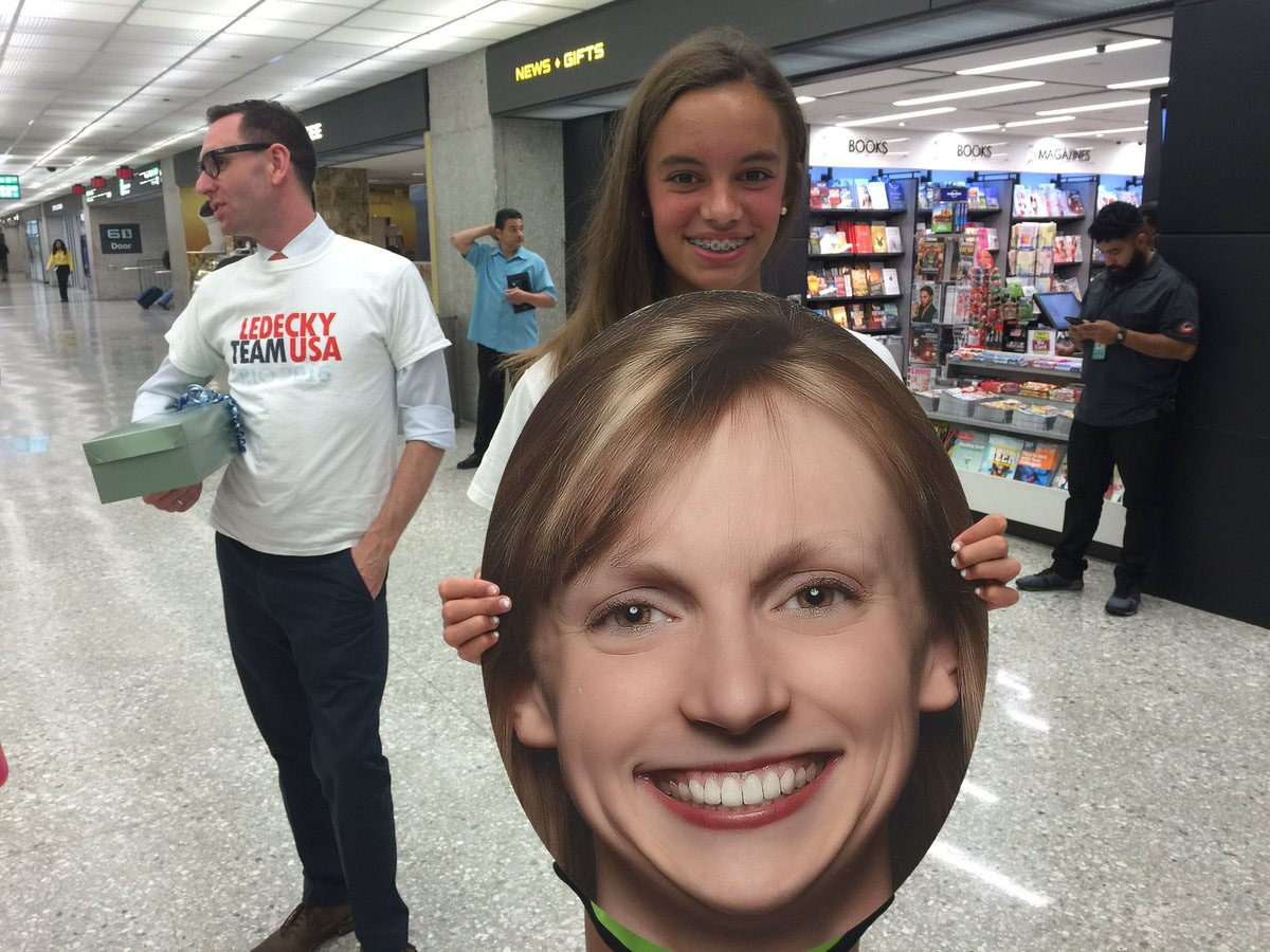 Classmate Alessa Mitchell awaits Katie Ledecky's arrival at Dulles International Airport on Aug. 17. Ledecky returns from Rio with four gold medals and one silver medal. (WTOP/Kristi King)