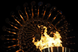 Flames burn in the Olympic cauldron after being lit during the opening ceremony of the 2016 Summer Olympics in Rio de Janeiro, Brazil, Saturday, Aug. 6, 2016. (AP Photo/Gregory Bull)