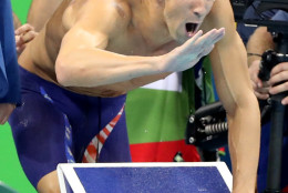 United States' Michael Phelps encourages his teammates in the final of the men's 4x100-meter freestyle relay during the swimming competitions at the 2016 Summer Olympics, Sunday, Aug. 7, 2016, in Rio de Janeiro, Brazil. (AP Photo/Lee Jin-man)