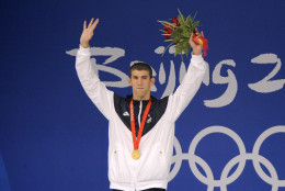 U.S. Swimmer Michael Phelps during gold medal ceremony for the men's 200-meter butterfly final during the swimming competitions in the National Aquatics Center at the Beijing 2008 Olympics in Beijing, Wednesday, Aug. 13, 2008. Phelps set a world record in the event. (AP Photo/Mark J. Terrill)