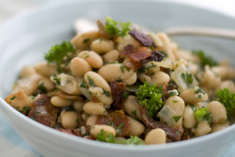 This March 15, 2011 photo shows warm bean and bacon salad in Concord, N.H.  Jacques Pepin's salad recipe calls for small white navy beans, but you can substitute any similar variety.   (AP Photo/Matthew Mead)