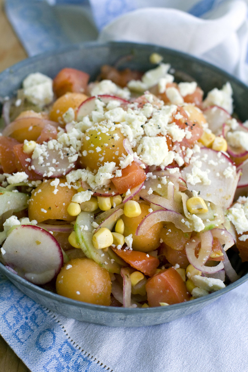 This June 6, 2011 photo shows tomato, corn and melon summer salad in Concord, N.H.  For AP's 20 Salads of Summer series, chef Nate Appleman offered this robustly flavored salad of tomatoes, raw corn and cantaloupe dressed with a jalapeno vinaigrette.    (AP Photo/Matthew Mead)