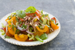 This Aug. 1, 2011 photo shows heirloom and cherry tomato salad in Concord, N.H.  For the AP's 20 Salads of Summer series, Alice Waters offered this recipe for a simple but stunning salad.  (AP Photo/Matthew Mead)