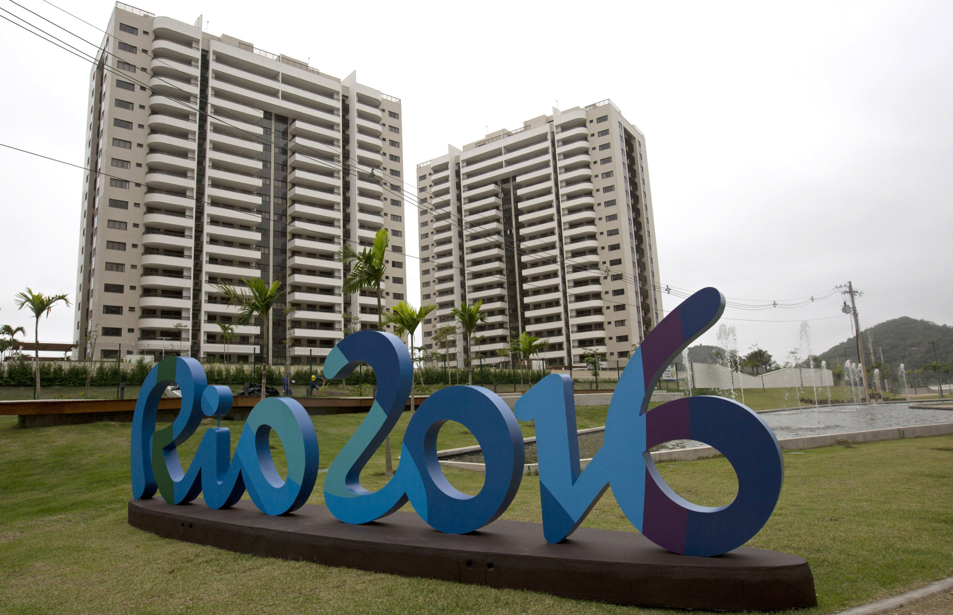 The Rio 2016 sign stands in front of the Olympic Village during a media tour in Rio de Janeiro, Brazil, Thursday, June 23, 2016. The organizers of the Rio de Janeiro Olympics have unveiled the athletes' village, where nearly 11,000 competitors and some 6,000 coaches and other team members will stay during the Aug. 5-21 games. (AP Photo/Silvia Izquierdo)