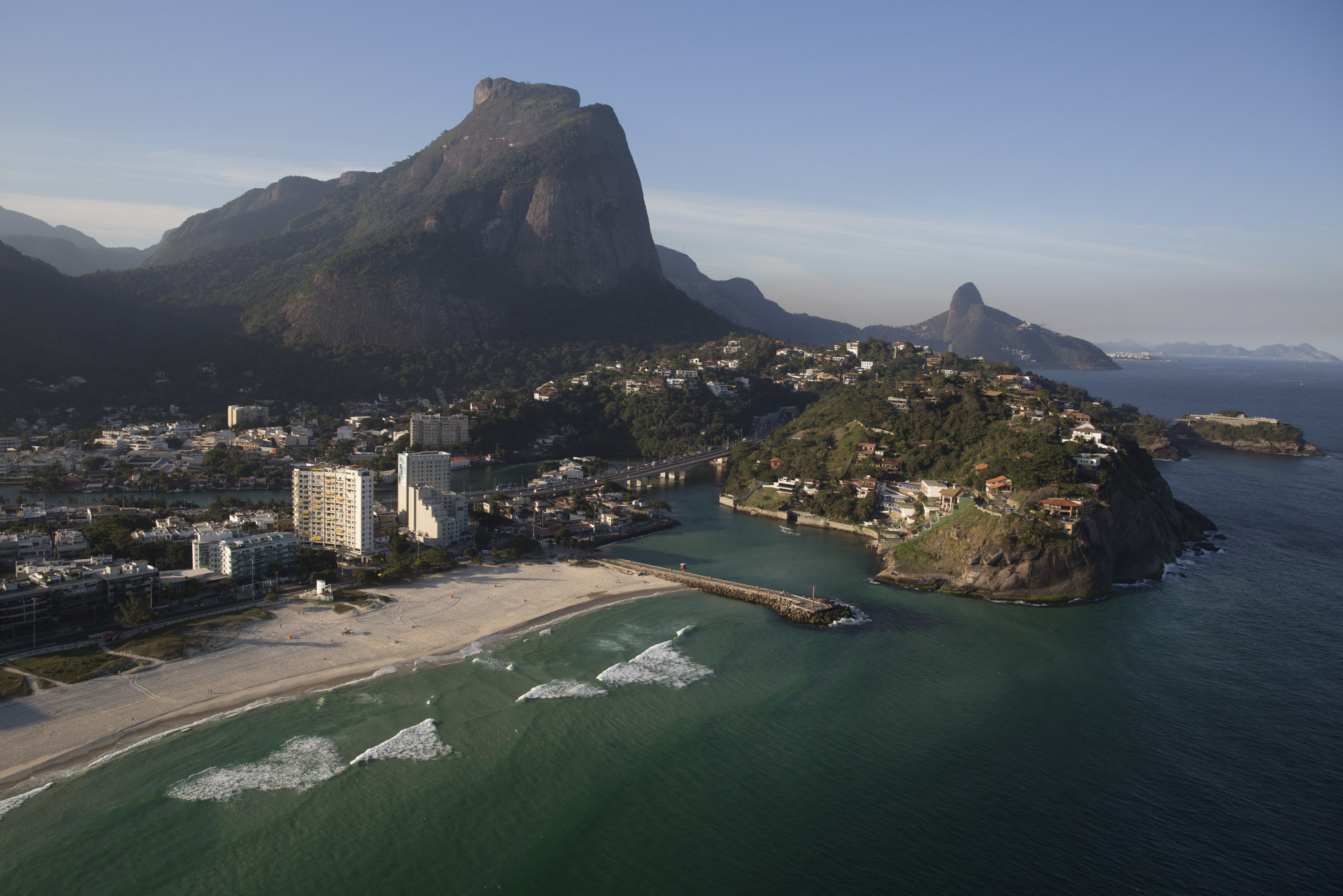The Barra da Tijuca beach is seen from the air, in Rio de Janeiro, Brazil, Monday, July 4, 2016. With the Olympics set to start on Aug. 5, the games and the city have been overshadowed by security threats, violence, the Zika virus and a national political corruption scandal. (AP Photo/Felipe Dana)