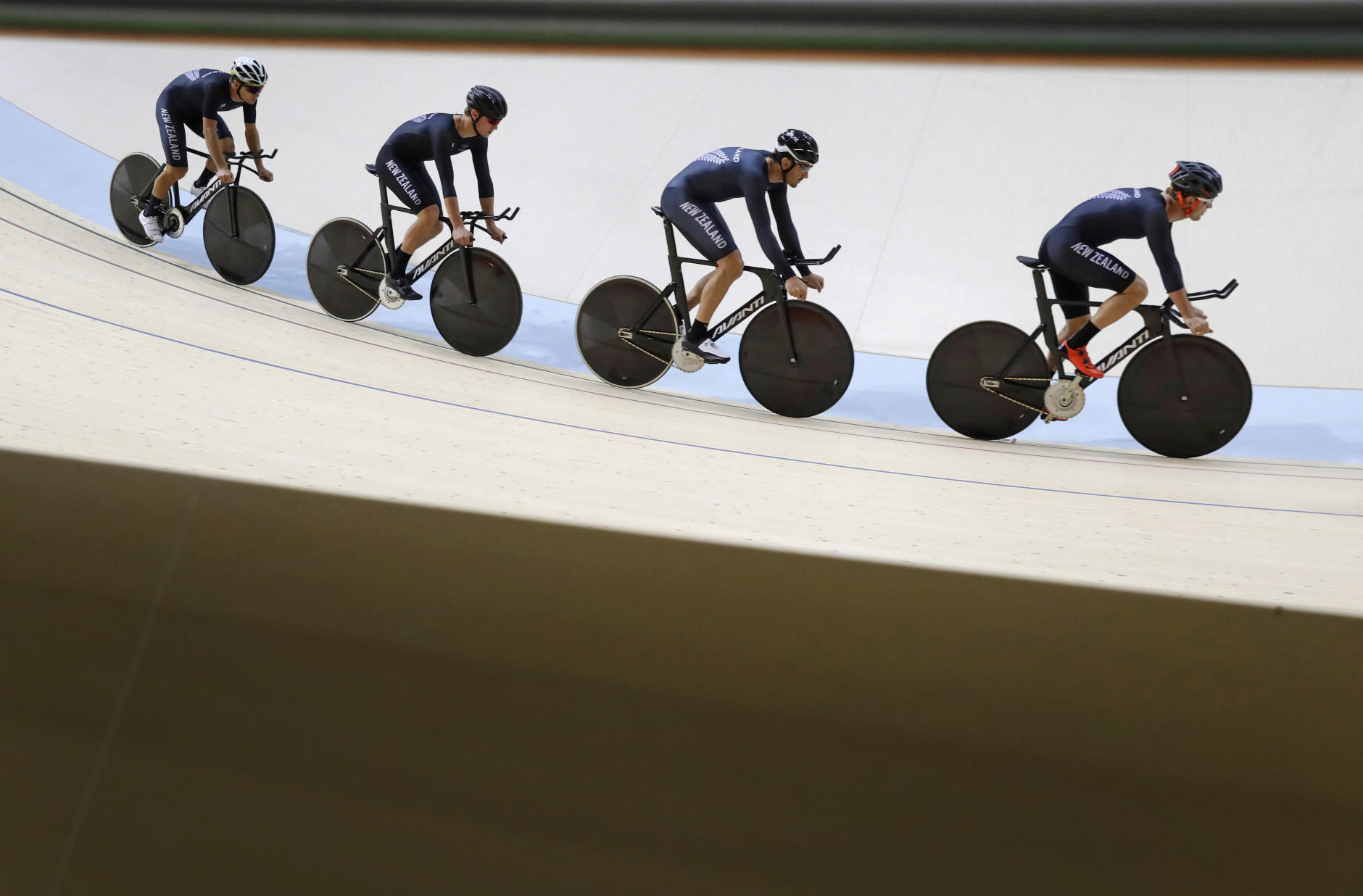 Members of the New Zealand men's track cycling team round the track during a training session inside the Rio Olympic Velodrome in advance of the 2016 Olympic Games in Rio de Janeiro, Brazil, Wednesday, Aug. 3, 2016. (AP Photo/Patrick Semansky)