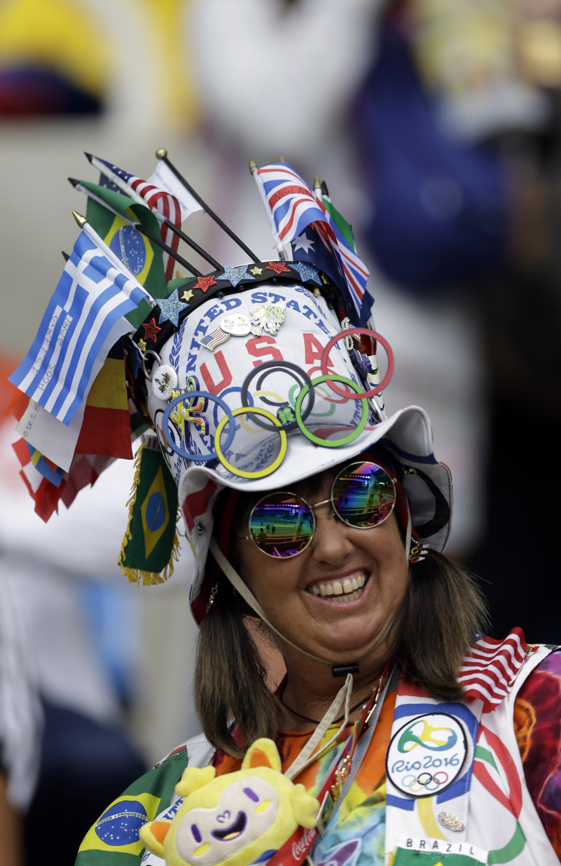 A fan waits for the start of a Group E match of the Women's Olympic Football Tournament between Brazil and China at the Rio Olympic Stadium in Rio de Janeiro, Brazil, Wednesday, Aug. 3, 2016.(AP Photo/Leo Correa)