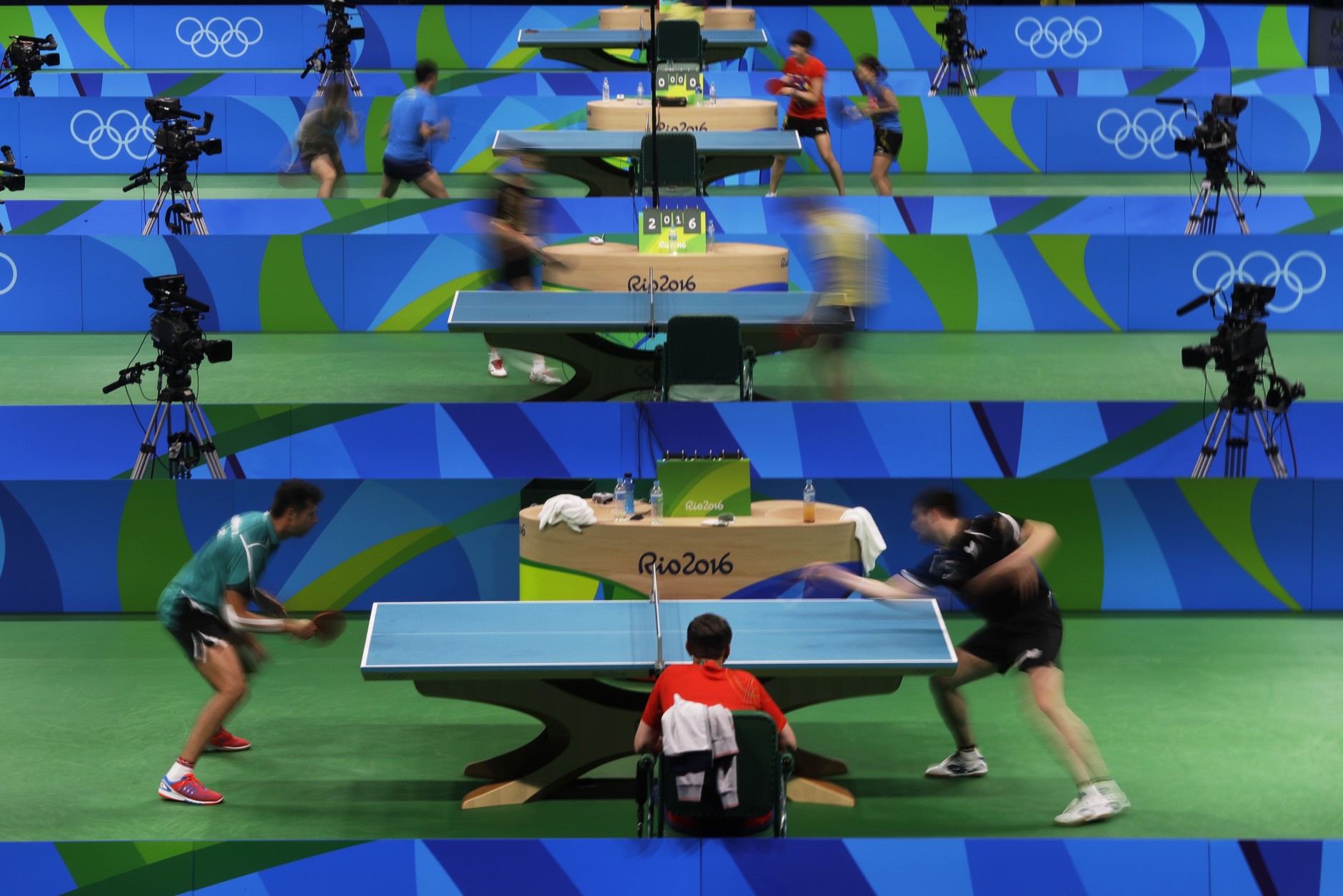 Table tennis players take part in a training session at the at the Riocentro ahead the 2016 Summer Olympics in Rio de Janeiro, Brazil, Wednesday, Aug. 3, 2016. (AP Photo/Petros Giannakouris)