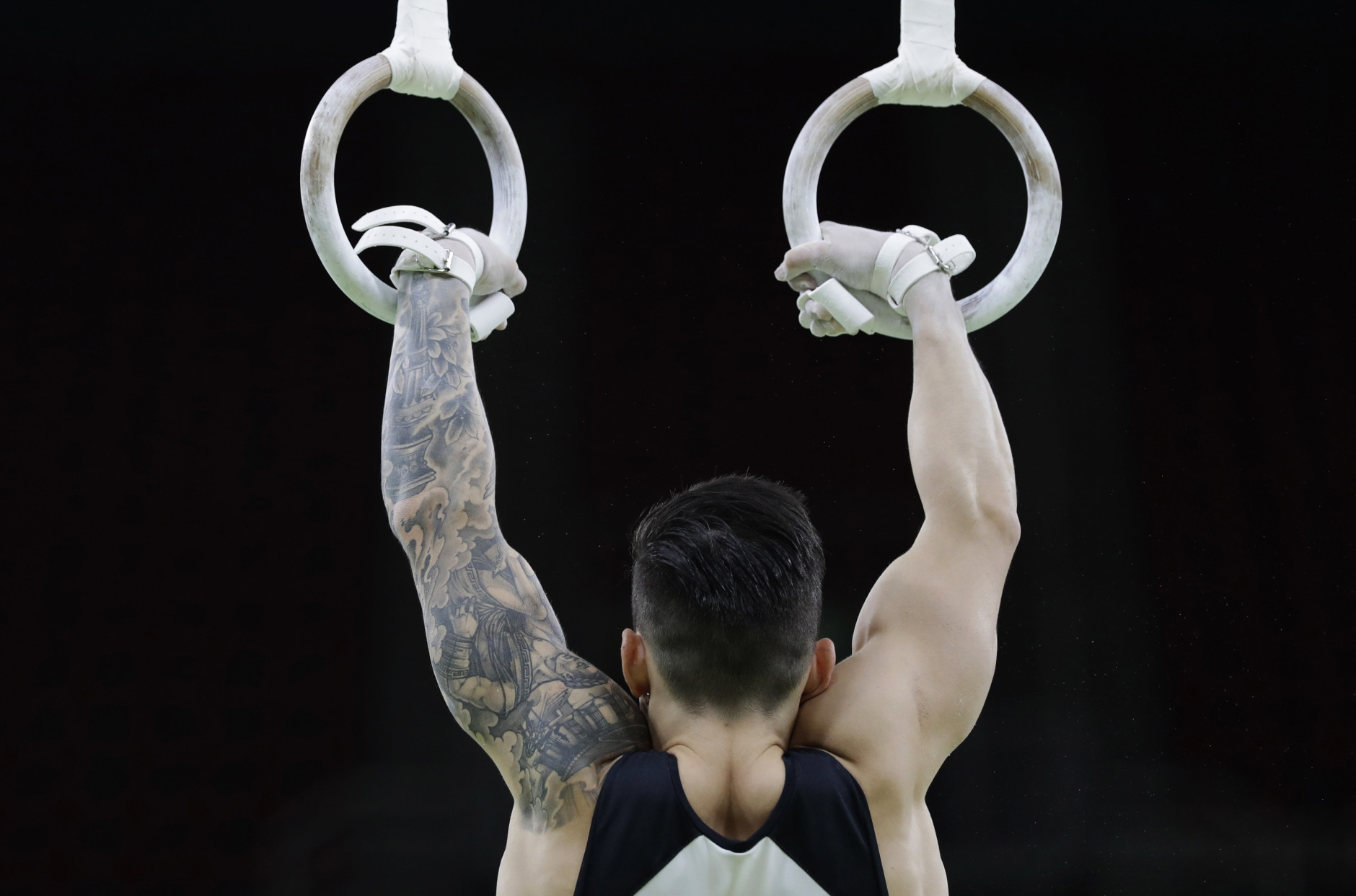 German gymnast Marcel Nguyen trains on the rings ahead of the 2016 Summer Olympics in Rio de Janeiro, Brazil, Wednesday, Aug. 3, 2016. (AP Photo/Rebecca Blackwell)