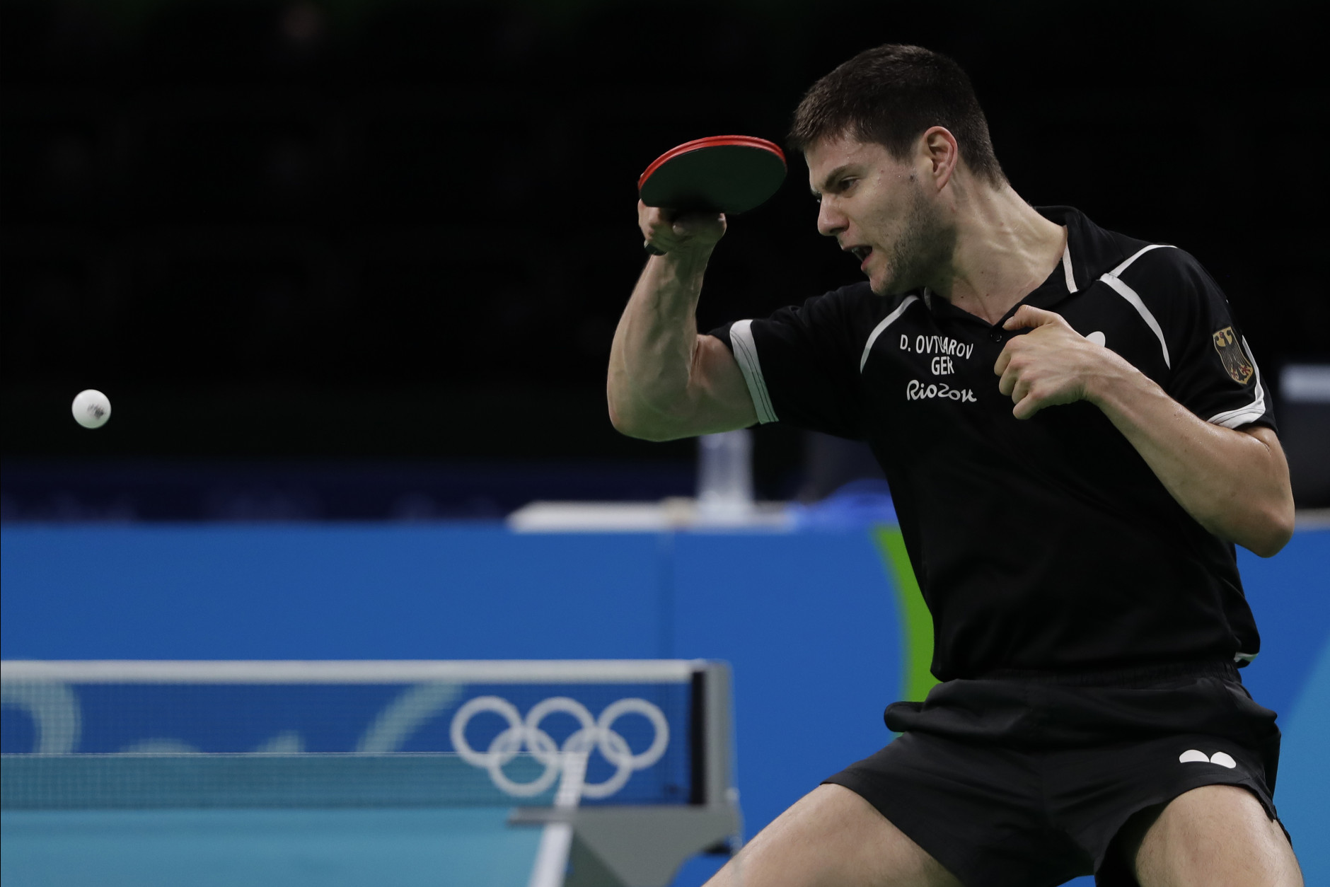 Germany's Dimitrij Ovtcharov throws a forehand during a table tennis training session ahead the 2016 Summer Olympics in Rio de Janeiro, Brazil, Wednesday, Aug. 3, 2016. (AP Photo/Petros Giannakouris)