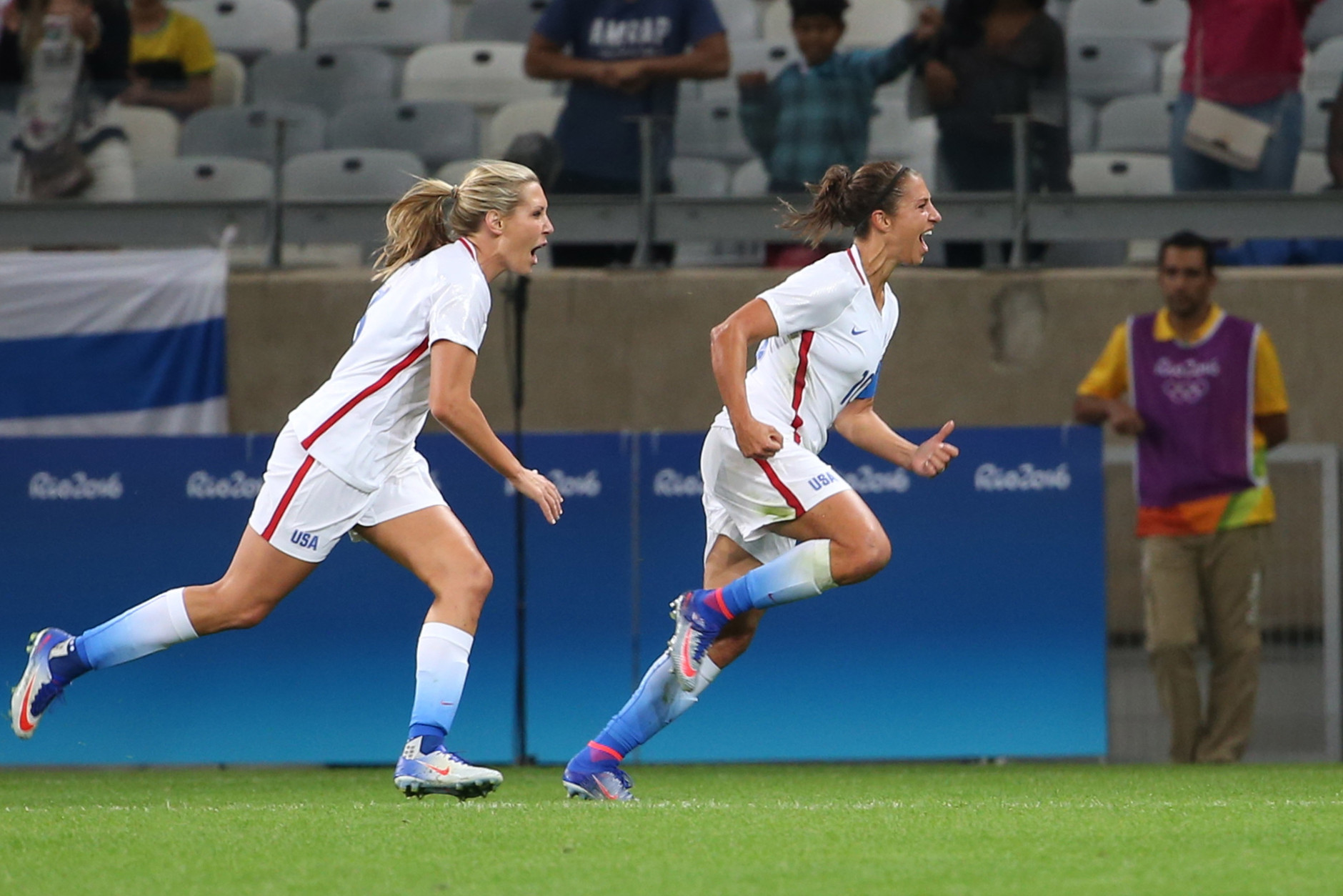United States' Carli Lloyd, right, celebrates after scoring against New Zealand during a Women's Olympic Football Tournament match at the Mineirao stadium in Belo Horizonte, Brazil, Wednesday, Aug. 3, 2016. (AP Photo/Eugenio Savio)