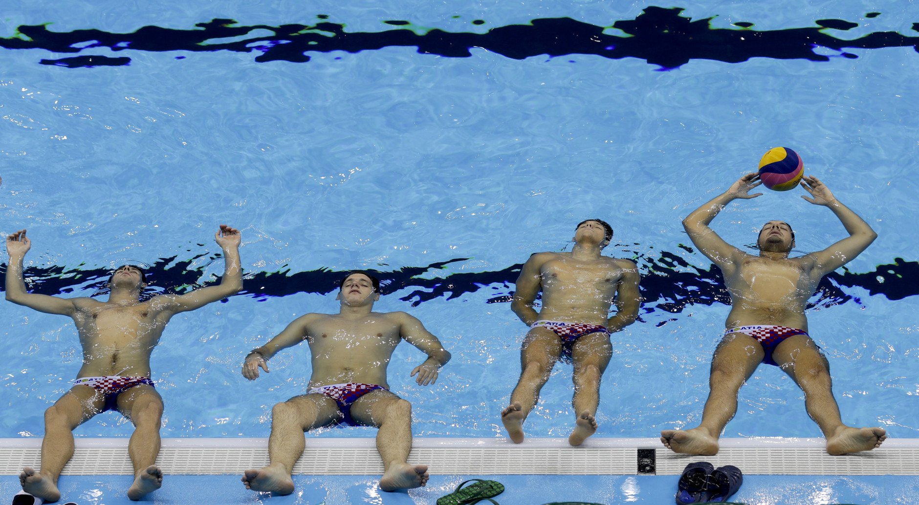 Croatia's water polo team exercise inside the pool at the Olympic village ahead of the 2016 Summer Olympics in Rio de Janeiro, Brazil, Wednesday, Aug. 3, 2016. The Games opening ceremony is on Friday.(AP Photo/Natacha Pisarenko)