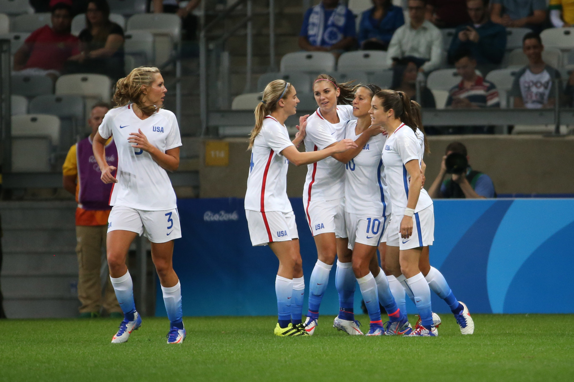 United States' players celebrates after their teammate Carli Lloyd, second right, scored against New Zealand during a Women's Olympic Football Tournament match at the Mineirao stadium in Belo Horizonte, Brazil, Wednesday, Aug. 3, 2016. (AP Photo/Eugenio Savio)