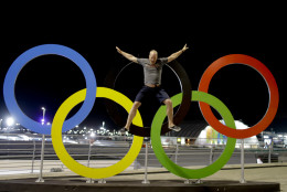 Adam Kreek jumps from the Olympic rings, while posing for a video, prior to the Summer Olympics in Rio de Janeiro, Brazil, Wednesday, Aug. 3, 2016. The Games opening ceremony is on Friday.(AP Photo/Natacha Pisarenko)