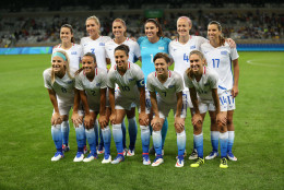 The United States Women's Olympic Football team poses for photos prior to a match against New Zealand during a Women's Olympic Football Tournament match at the Mineirao stadium in Belo Horizonte, Brazil, Wednesday, Aug. 3, 2016. (AP Photo/Eugenio Savio)