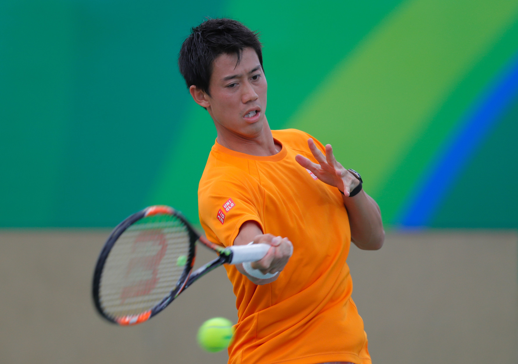 Kei Nishikori of Japan, returns a ball during a practice session ahead of the upcoming 2016 Summer Olympics in Rio de Janeiro, Brazil, Wednesday, Aug. 3, 2016. (AP Photo/Vadim Ghirda)