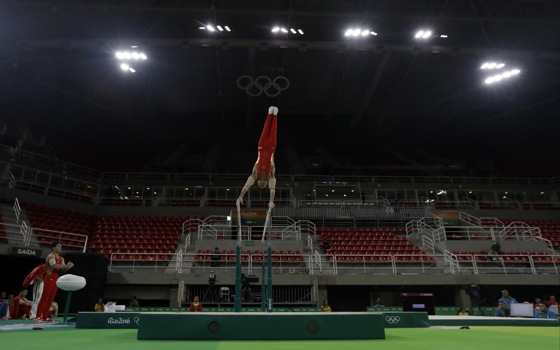 China's gymnast You Hao trains on the parallel bars ahead of the 2016 Summer Olympics in Rio de Janeiro, Brazil, Wednesday, Aug. 3, 2016. (AP Photo/Julio Cortez)