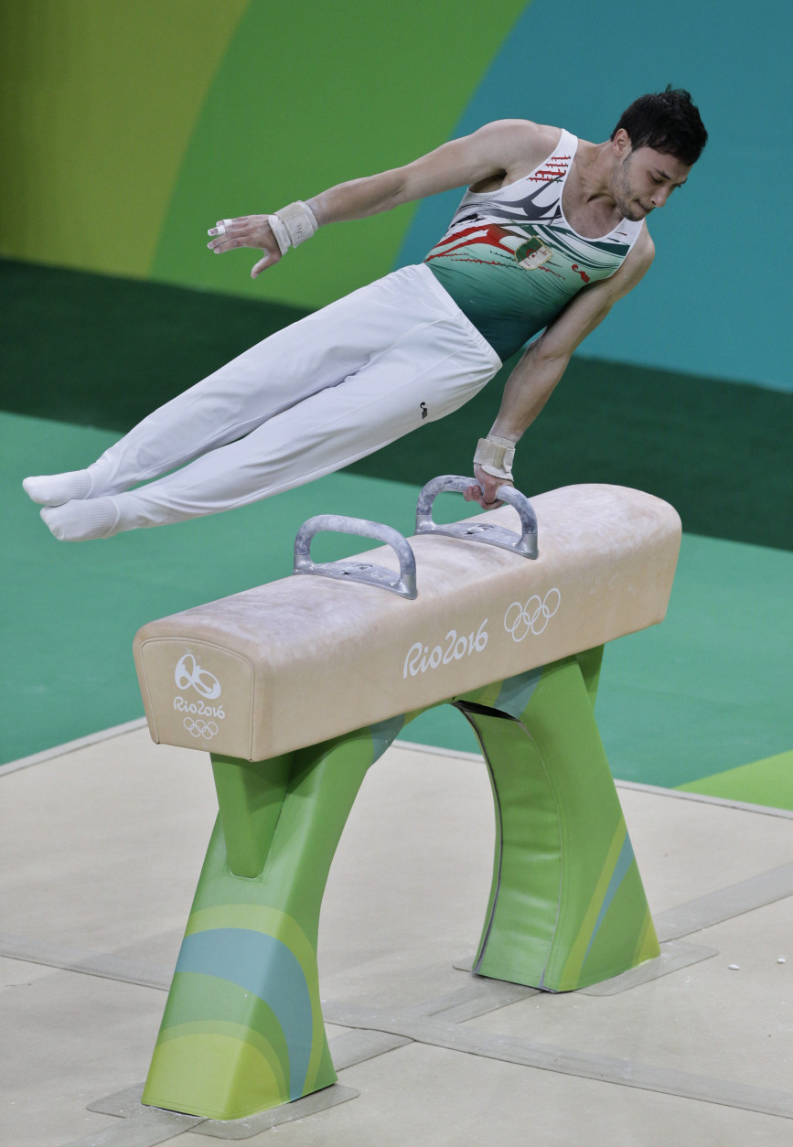 Algeria's Mohamed Abdeldjalil Bourguieg trains on the pommel horse ahead of the 2016 Summer Olympics in Rio de Janeiro, Brazil, Wednesday, Aug. 3, 2016. (AP Photo/Rebecca Blackwell)