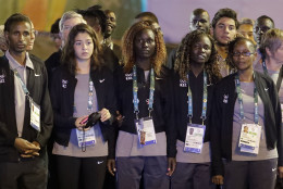 Members of the Refugee Olympic Team watch a performance during a welcome ceremony at the Olympic athletes village in Rio de Janeiro, Brazil, Wednesday, Aug. 3, 2016. The Summer 2016 Olympics is scheduled to open Aug. 5. (AP Photo/Charlie Riedel)