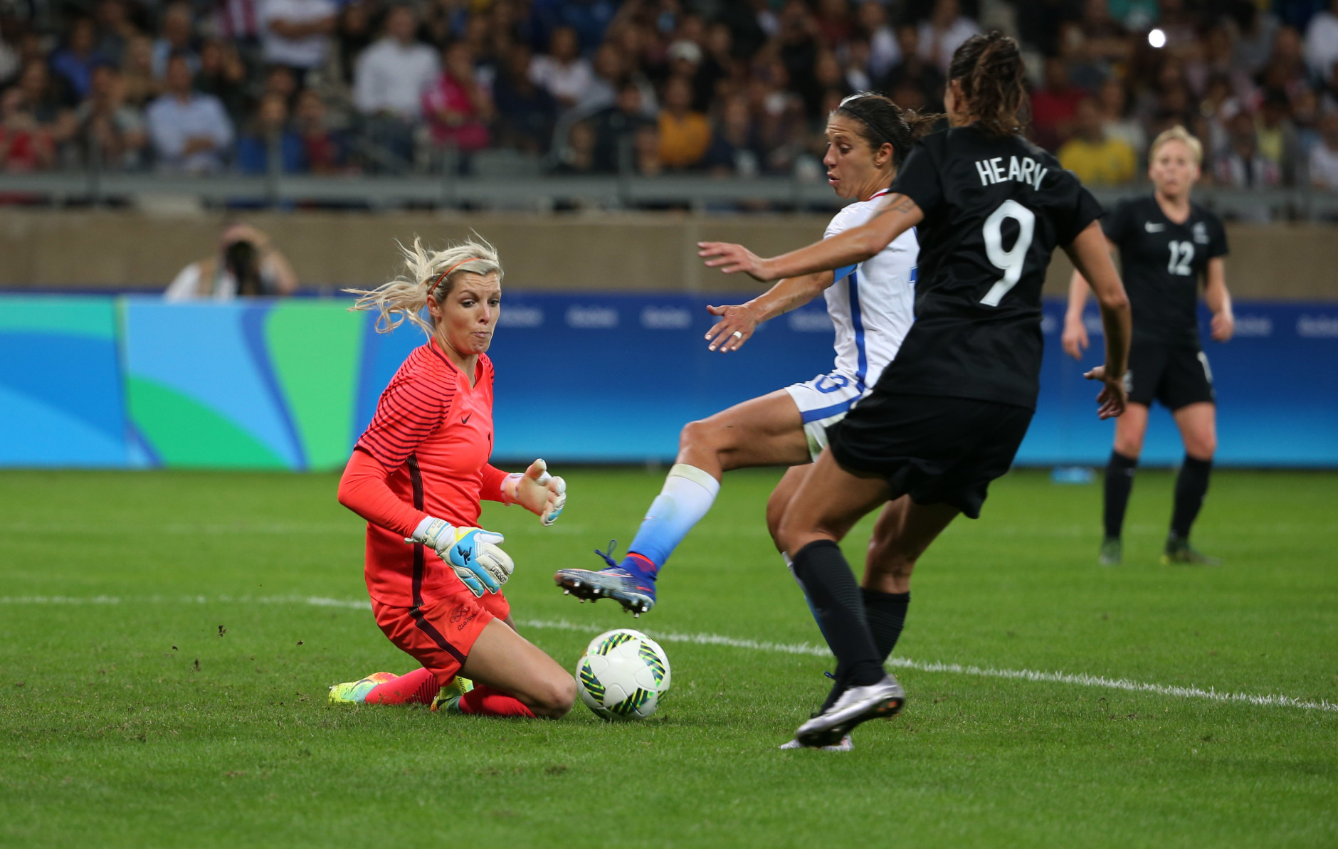 New Zealand goalkeeper Erin Nayler, left, and Amber Hearn watch the ball as United States' Carli Lloyd, center, tries to score during a women's Olympic football tournament match at the Mineirao stadium in Belo Horizonte, Brazil, Wednesday, Aug. 3, 2016. United States won 2-0. (AP Photo/Eugenio Savio)