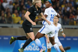 New Zealand's Betsy Hassett, left, and United States' Crystal Dunn jump for the ball during a women's Olympic football tournament match at the Mineirao stadium in Belo Horizonte, Brazil, Wednesday, Aug. 3, 2016. United States won 2-0. (AP Photo/Eugenio Savio)