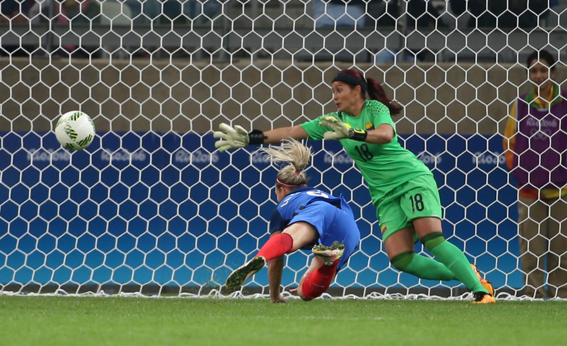 France's Eugenie Le Sommer, bottom, scores a goal past Colombia goalkeeper Catalina Perez during the Women's Olympic Football Tournament at the Mineirao stadium in Belo Horizonte, Brazil, Wednesday, Aug. 3, 2016. (AP Photo/Eugenio Savio)