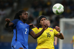 France's Griedge Mbock Bathy, left, fights for the ball with Colombia's Lady Andrade during the Women's Olympic Football Tournament at the Mineirao stadium in Belo Horizonte, Brazil, Wednesday, Aug. 3, 2016. (AP Photo/Eugenio Savio)