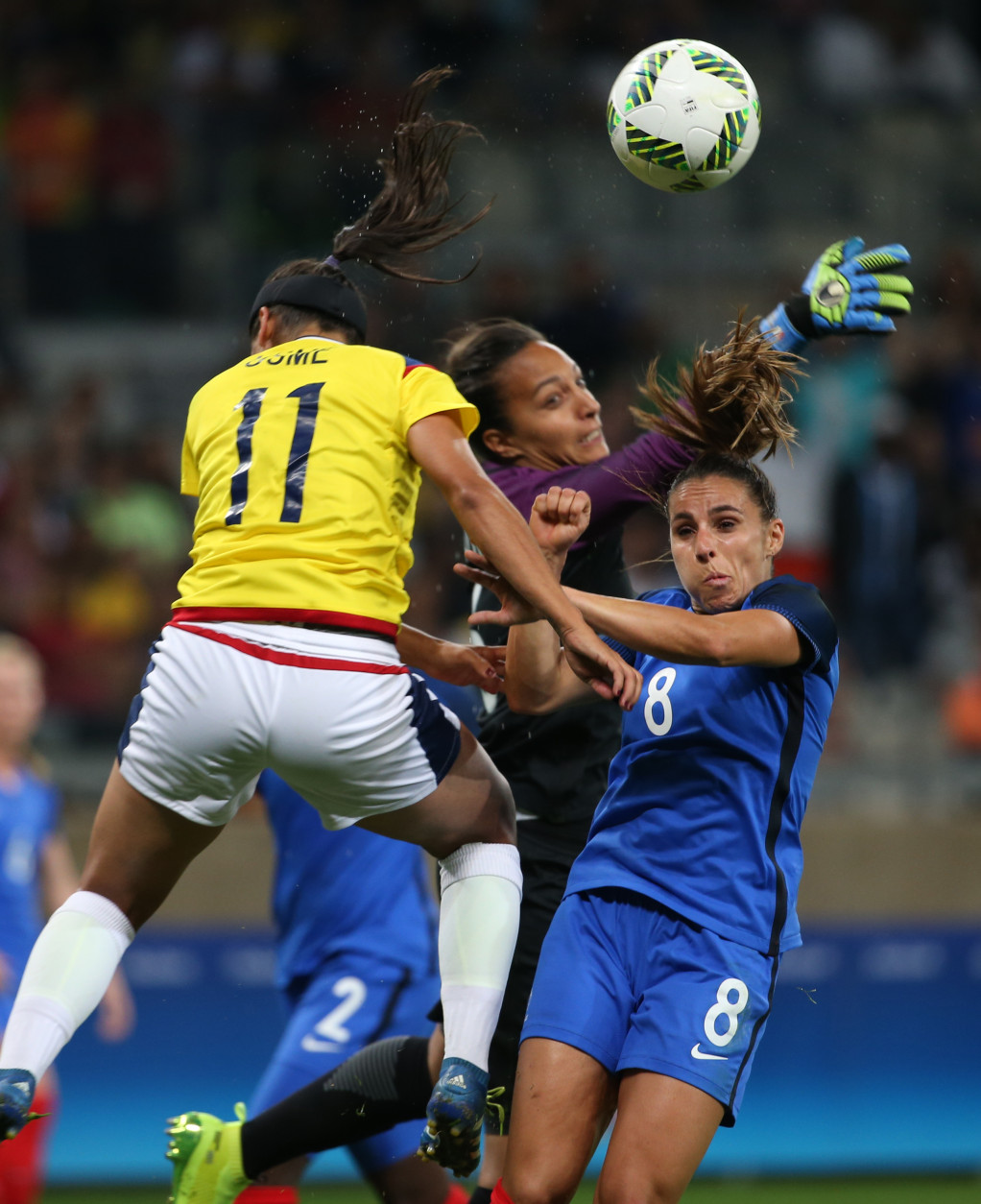 Colombia's Catalina Usme, left, France goalkeeper Sarah Bouhaddi, center, and France's Jessica Houara fight for the ball during the Women's Olympic Football Tournament at the Mineirao stadium in Belo Horizonte, Brazil, Wednesday, Aug. 3, 2016. (AP Photo/Eugenio Savio)