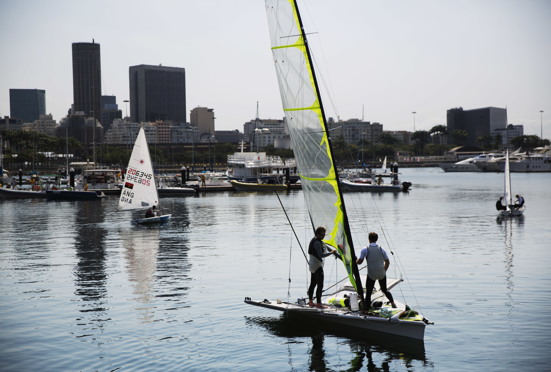 Thomas Barrows, left, and Joe Morris, of the United States men's sailing team, set out for a practice session ahead of the upcoming 2016 Summer Olympics in Rio de Janeiro, Brazil, Thursday, Aug. 4, 2016. (AP Photo/David Goldman)