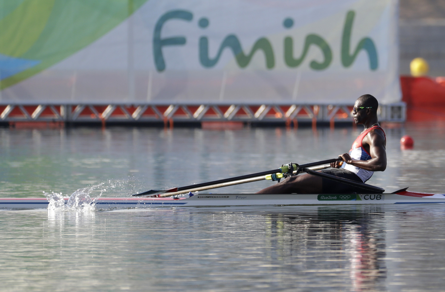 Angel Fournier Rodriguez, of Cuba, competes in the men's single scull heat during the 2016 Summer Olympics in Rio de Janeiro, Brazil, Saturday, Aug. 6, 2016. (AP Photo/Andre Penner)