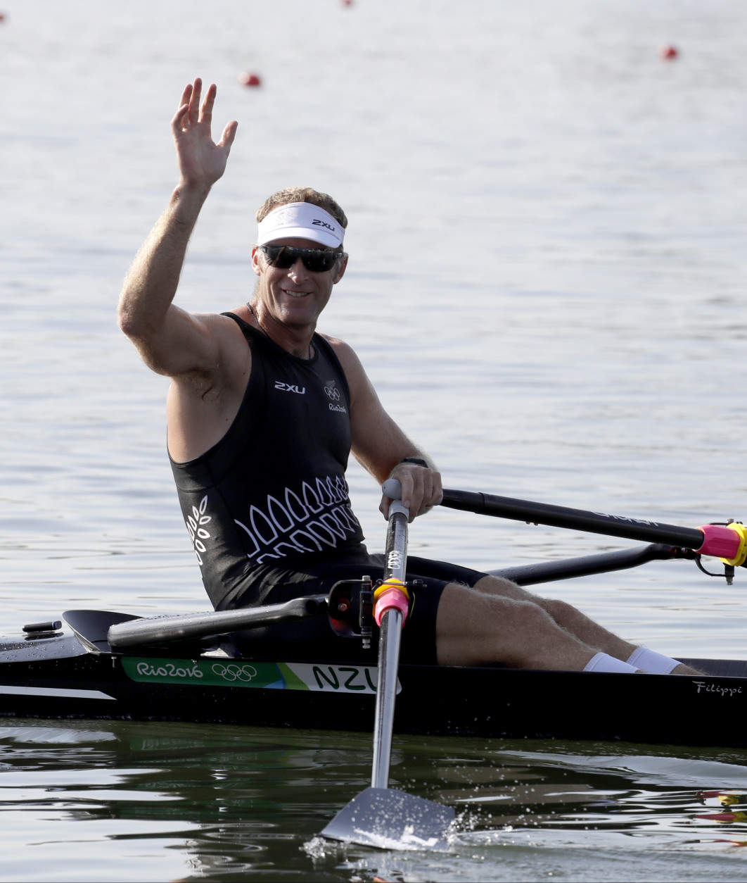 Mahe Drysdale, of New Zealand, waves after competing in the men's single scull heat during the 2016 Summer Olympics in Rio de Janeiro, Brazil, Saturday, Aug. 6, 2016. (AP Photo/Andre Penner)