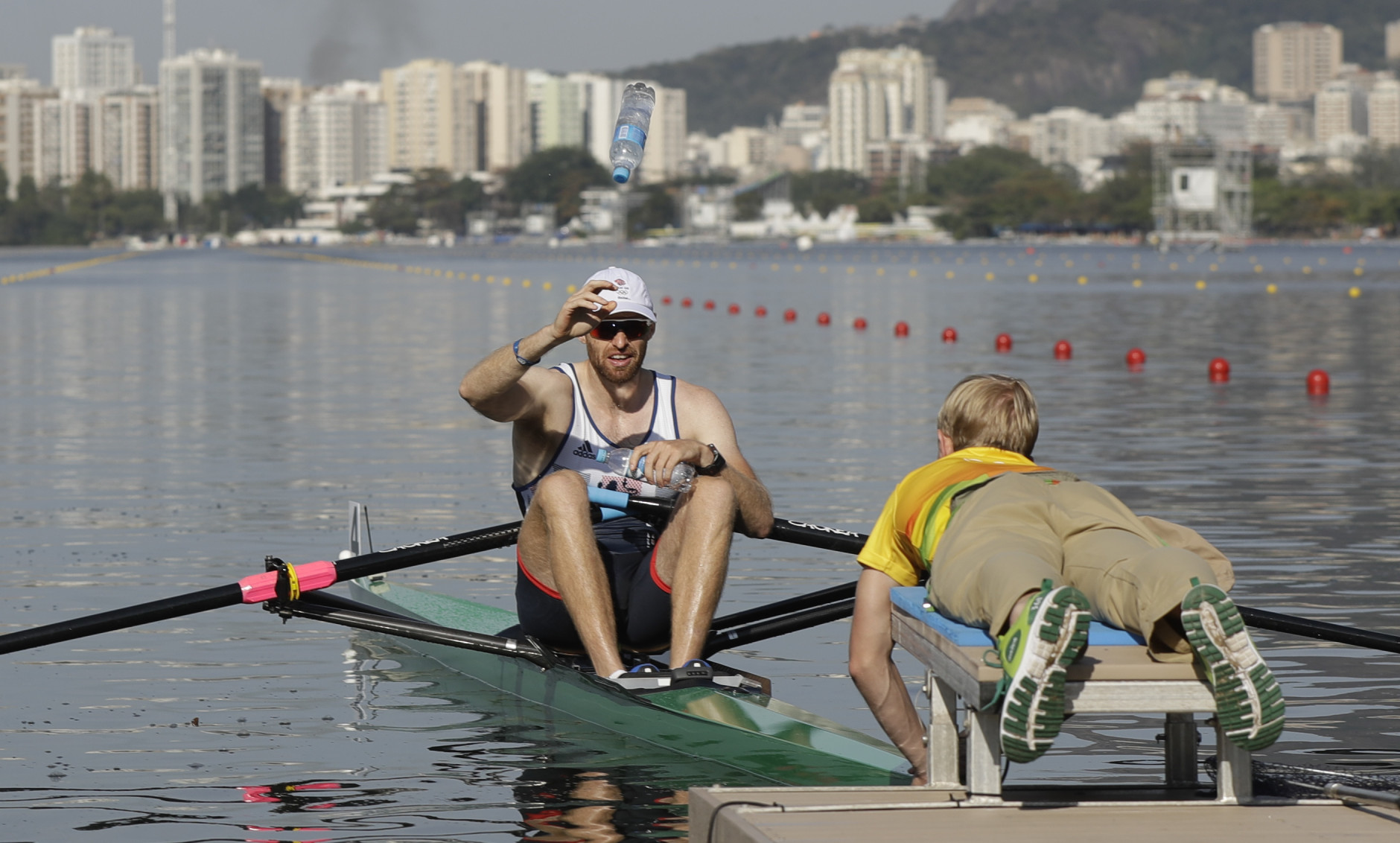 Gret Britain's Alan Campbell launches a bottle of water before competing in the rowing Men's single sculls in Lagoa during the 2016 Summer Olympics in Rio de Janeiro, Brazil, Saturday, Aug. 6, 2016. (Luca Bruno)