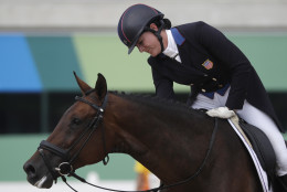 Lauren Kieffer, of the United States, reacts on Veronica after competing in the equestrian eventing dressage competition at the 2016 Summer Olympics in Rio de Janeiro, Brazil, Sunday, Aug. 7, 2016. (AP Photo/John Locher)