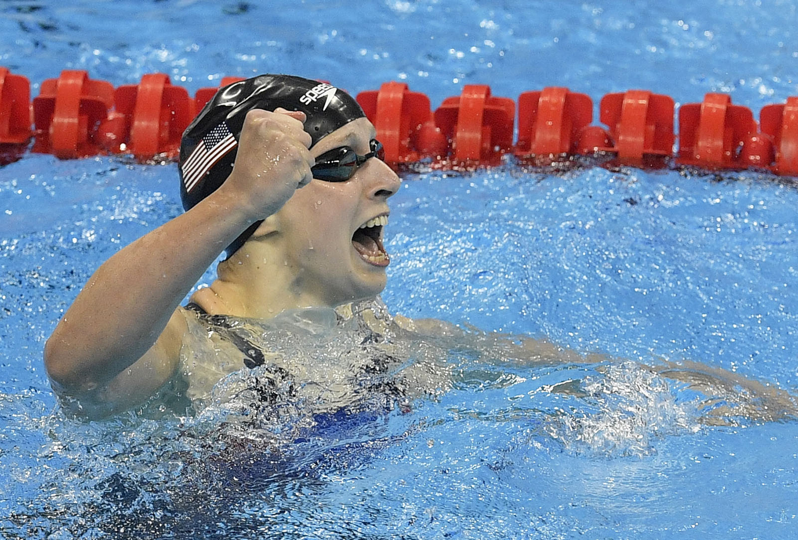 United States' Katie Ledecky celebrates after setting a new world record in the women's 400-meter freestyle final during the swimming competitions at the 2016 Summer Olympics, Sunday, Aug. 7, 2016, in Rio de Janeiro, Brazil. (AP Photo/Martin Meissner)