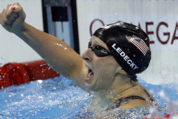 United States' Katie Ledecky celebrates winning the gold medal in the women's 400-meter freestyle setting a new world record during the swimming competitions at the 2016 Summer Olympics, Sunday, Aug. 7, 2016, in Rio de Janeiro, Brazil. (AP Photo/Matt Slocum)