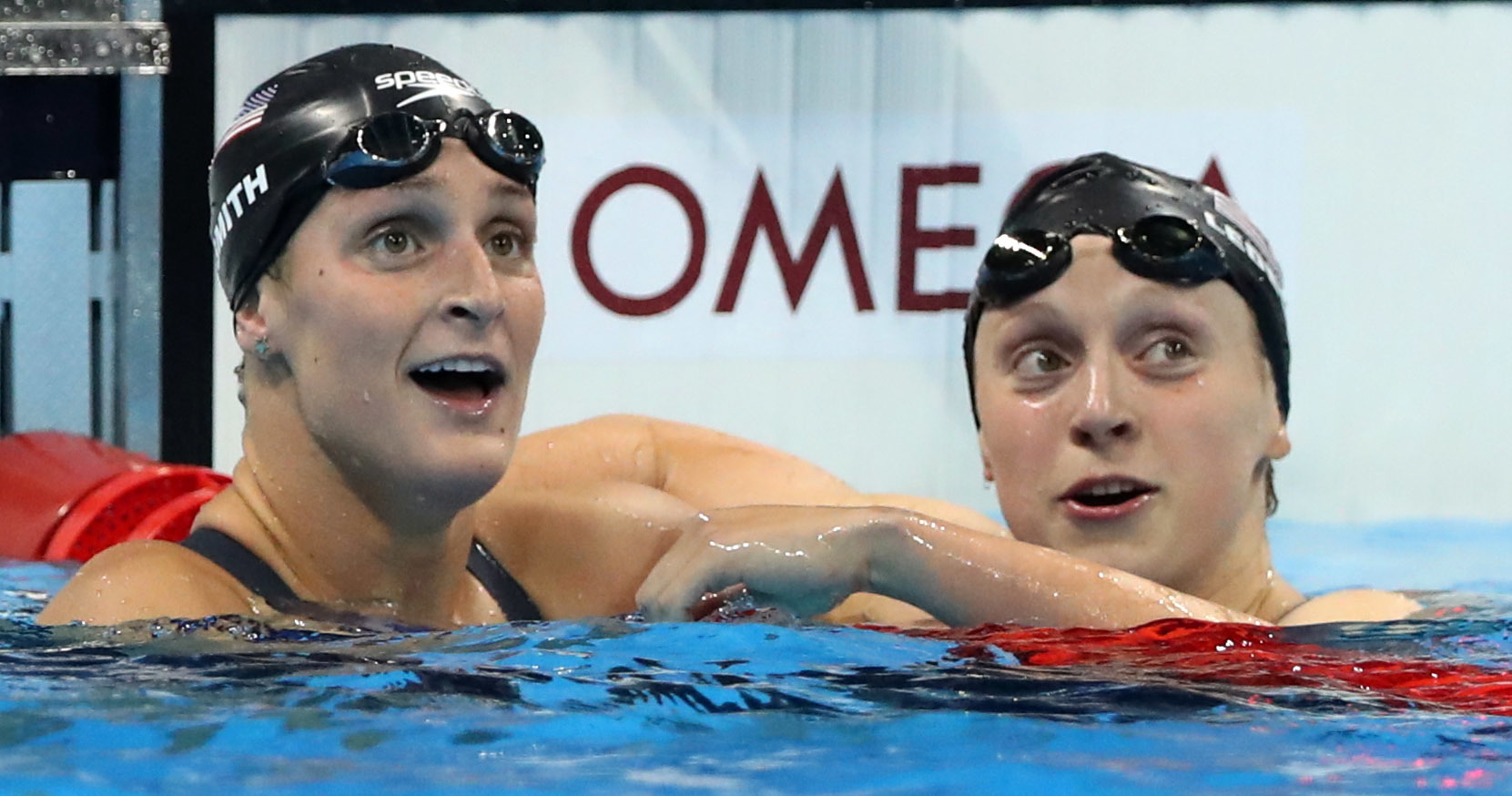 United States' Katie Ledecky, right, looks up with United States' Leah Smith after winning the gold medal in the women's 400-meter freestyle setting a new world record during the swimming competitions at the 2016 Summer Olympics, Sunday, Aug. 7, 2016, in Rio de Janeiro, Brazil. (AP Photo/Lee Jin-man)