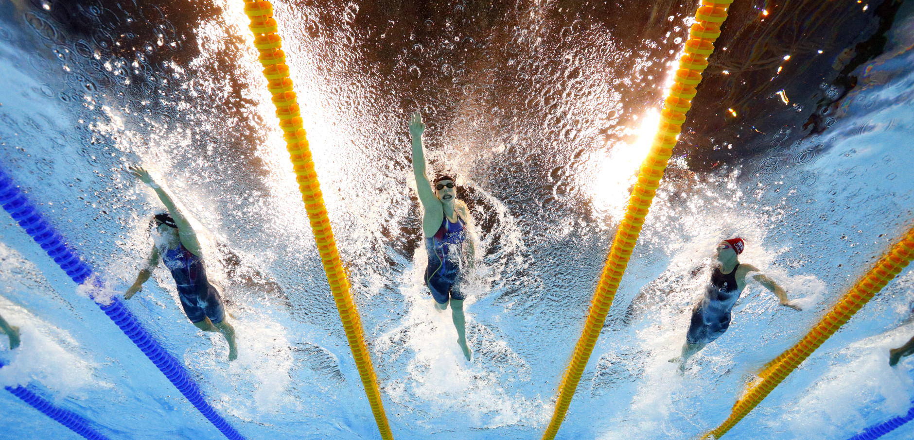 United States' Katie Ledecky, center, competes in the final of the women's 400-meter freestyle during the swimming competitions at the 2016 Summer Olympics, Sunday, Aug. 7, 2016, in Rio de Janeiro, Brazil. (AP Photo/David J. Phillip)