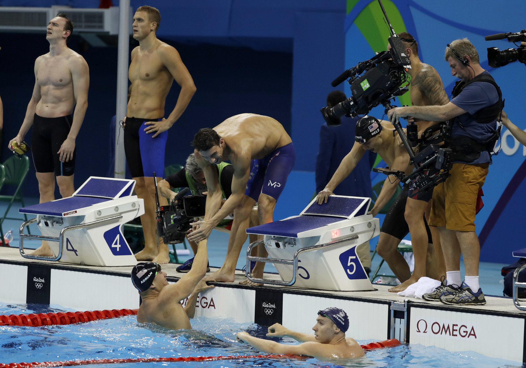United States' Michael Phelps greets United States' Nathan Adrian after winning the final of the men's 4x100-meter freestyle relay during the swimming competitions at the 2016 Summer Olympics, Sunday, Aug. 7, 2016, in Rio de Janeiro, Brazil. (AP Photo/Matt Slocum)