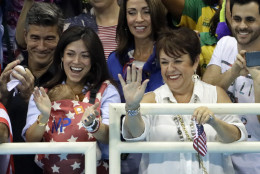 The family of United States' Michael Phelps, mother Debbie, right, and his fiance Nicole Johnson holding their baby Boomer during the swimming competitions at the 2016 Summer Olympics, Monday, Aug. 8, 2016, in Rio de Janeiro, Brazil. (AP Photo/David J. Phillip)