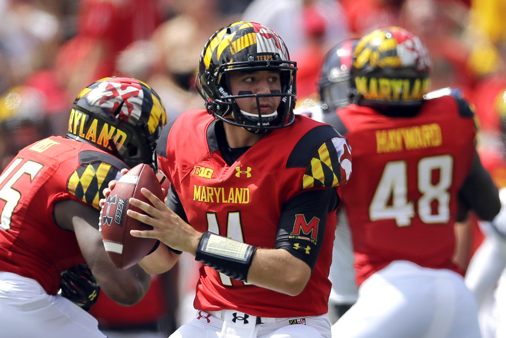 FILE - In this Sept. 5, 2015, file photo, Maryland quarterback Perry Hills looks for a receiver in the first half of an NCAA college football game against Richmond, in College Park, Md. (AP Photo/Patrick Semansky, FIle)