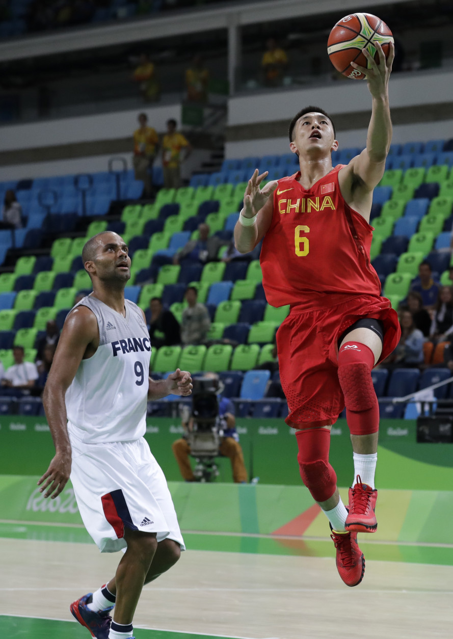 China's Guo Ailun (6) drives to the basket past France's Tony Parker (9) during a basketball game at the 2016 Summer Olympics in Rio de Janeiro, Brazil, Monday, Aug. 8, 2016. (AP Photo/Charlie Neibergall)