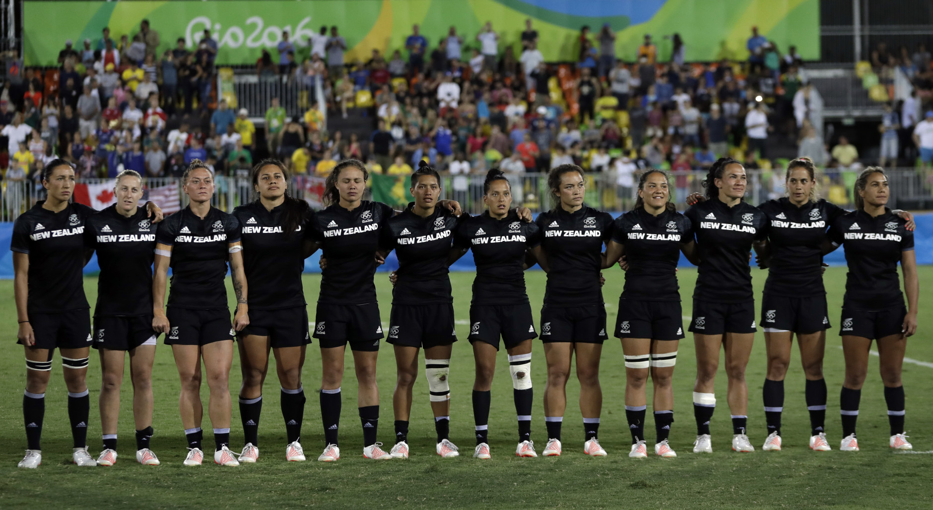 New Zealand's players line up for the singing of the national anthem during the women's rugby sevens gold medal match against Australia at the Summer Olympics in Rio de Janeiro, Brazil, Monday, Aug. 8, 2016. (AP Photo/Themba Hadebe)