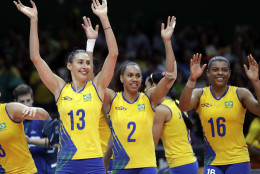 Team Brazil's Sheilla Castro de Paula Blassioli (13), Juciely Cristina Barreto (2) and Fernanda Rodrigues (16) wave to fans after defeating Argentina in a women's preliminary volleyball match at the 2016 Summer Olympics in Rio de Janeiro, Brazil, Tuesday, Aug. 9, 2016. (AP Photo/Jeff Roberson)