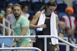 Hungary's Katinka Hosszu with Shane Tusup, her coach and husband, after winning a semifinal of the women's 200-meter individual medley during the swimming competitions at the 2016 Summer Olympics, Tuesday, Aug. 9, 2016, in Rio de Janeiro, Brazil. (AP Photo/Matt Slocum)