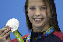 United States' Kathleen Baker shows off her silver medal during the ceremony for the women's 100-meter backstroke final during the swimming competitions at the 2016 Summer Olympics, Monday, Aug. 8, 2016, in Rio de Janeiro, Brazil. (AP Photo/Michael Sohn)