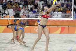 United States' Kerri Walsh Jennings, right, sets up against China during a women's beach volleyball match at the 2016 Summer Olympics in Rio de Janeiro, Brazil, Tuesday, Aug. 9, 2016. (AP Photo/Marcio Jose Sanchez)
